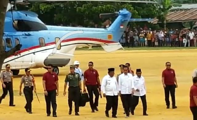 Lakukan Replanting, Jokowi Serahkan PTSL di Rohil