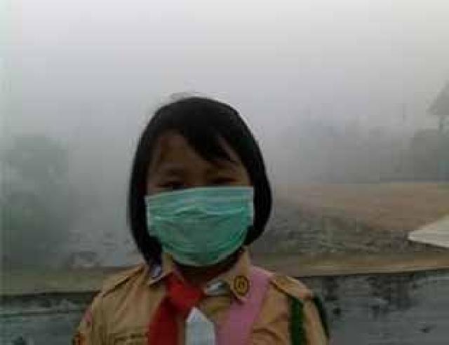 Karena Kabut Asap, Disdik Liburkan Pelajar Hingga Tingkat SMP Se Inhil